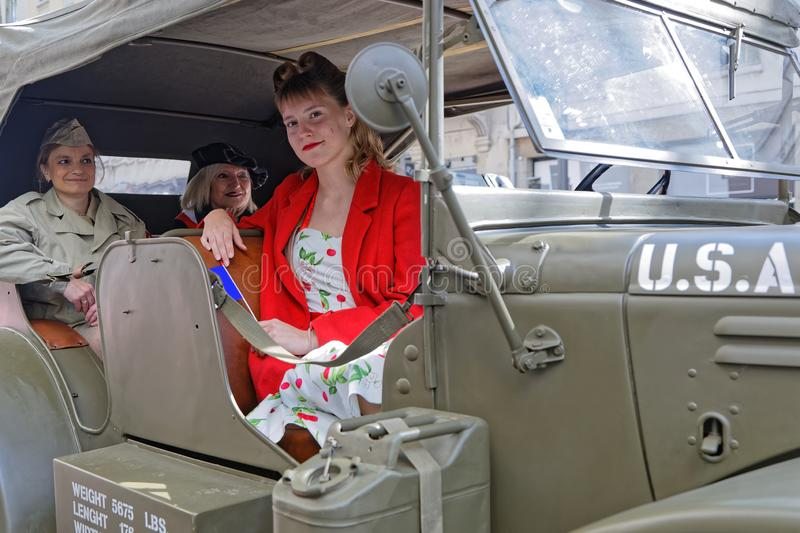 Youn women in a military vehicle royalty free stock image