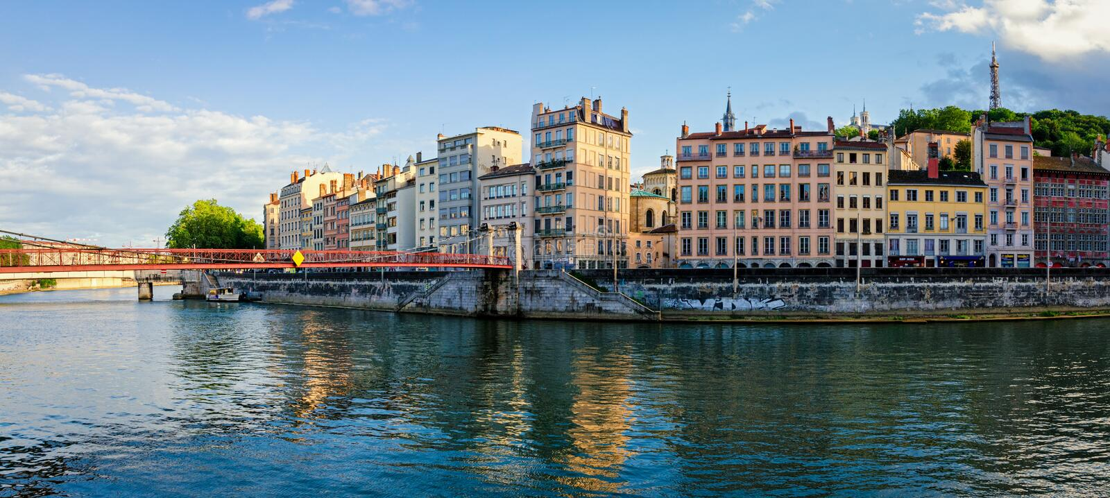 Lyon old buildings along river Saone. At sunset stock images