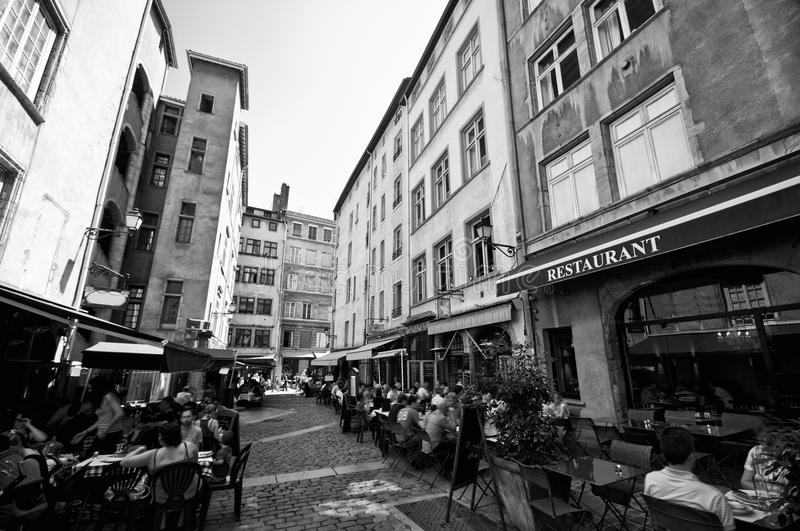 Lyon old town. Black and white image of old town French Lyon streets with outdoor cafe tables. This area has UNESCO heritage status stock images