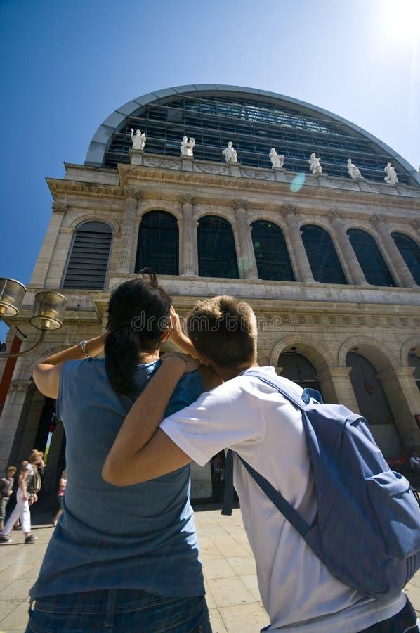 Lyon opera. Two tourists admiring impressive Lyon opera house royalty free stock photography