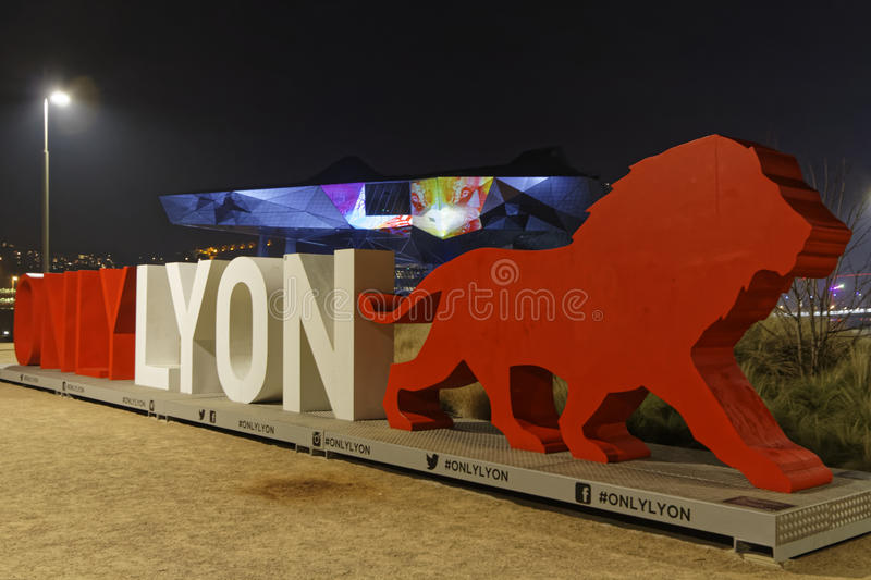 Only Lyon, the red lion and Confluence Museum. LYON, FRANCE, December 9, 2016 : Show on the new Musee des Confluences. The Festival of Lights expresses gratitude royalty free stock photos