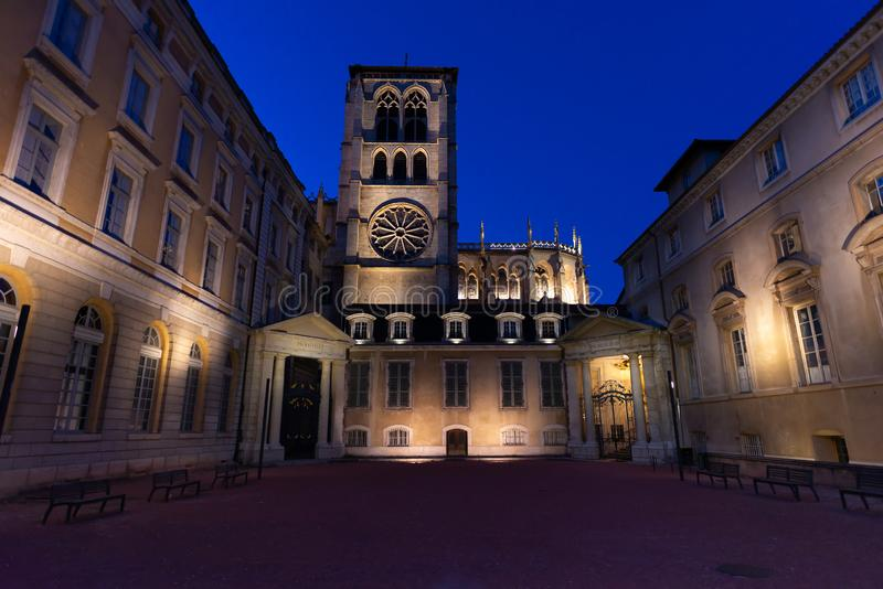 The Lyon`s bishopric at dusk, Lyon, France. The Lyon`s bishopric and the cathedral with dark blue clear sky, Lyon, France royalty free stock image