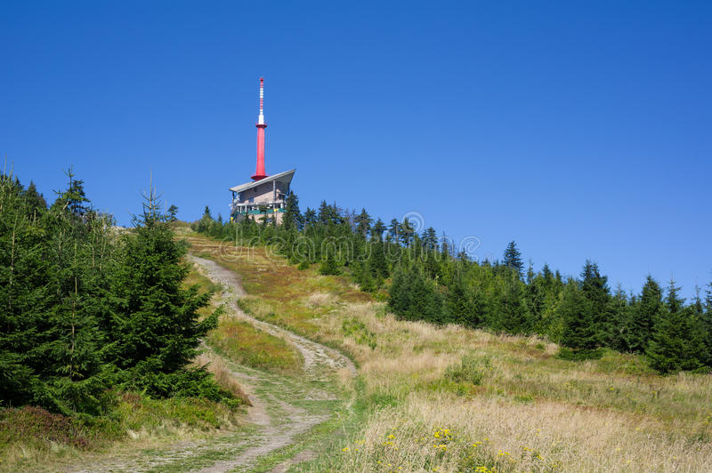 Lysa hora. Beskids mountains ( Beskydy ), Czech republic / Czechia, Central Europe - pathway leading to top of the hill. High building of Transmission tower on royalty free stock photo