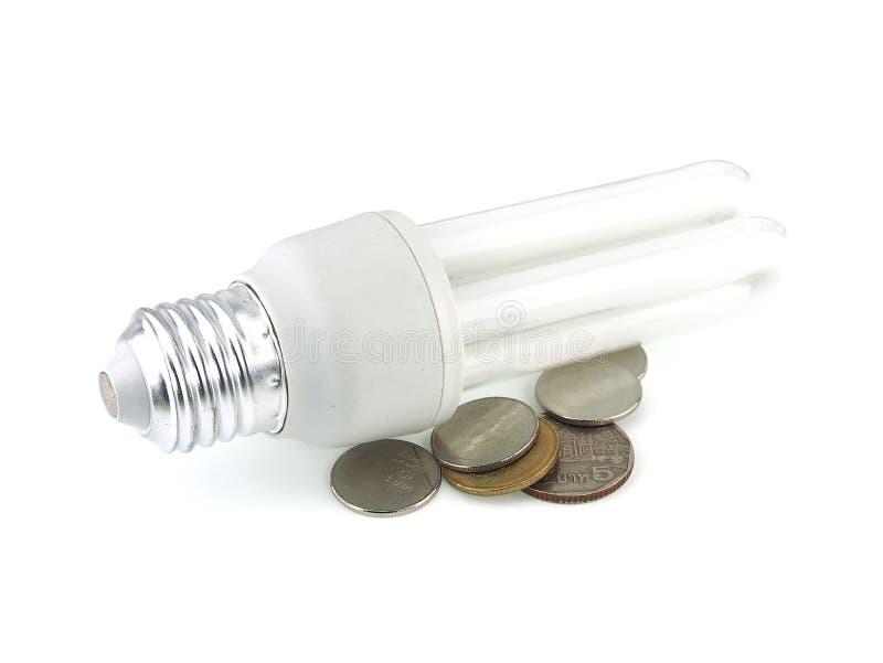 Lysrör och pengar arkivbilder