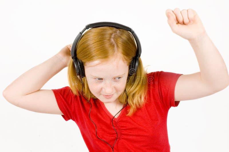 lyssnande musik för dansflicka till fotografering för bildbyråer