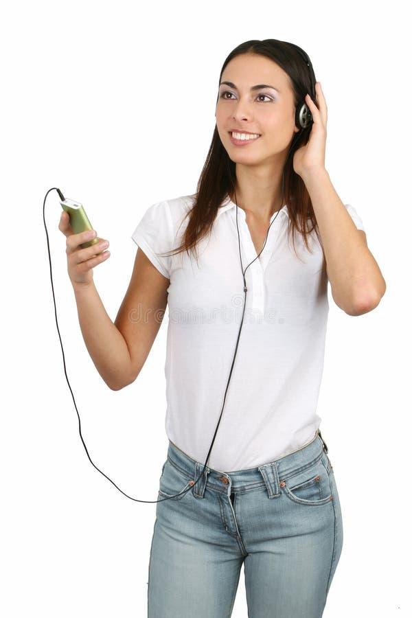 lyssnande musik för flicka till royaltyfri foto