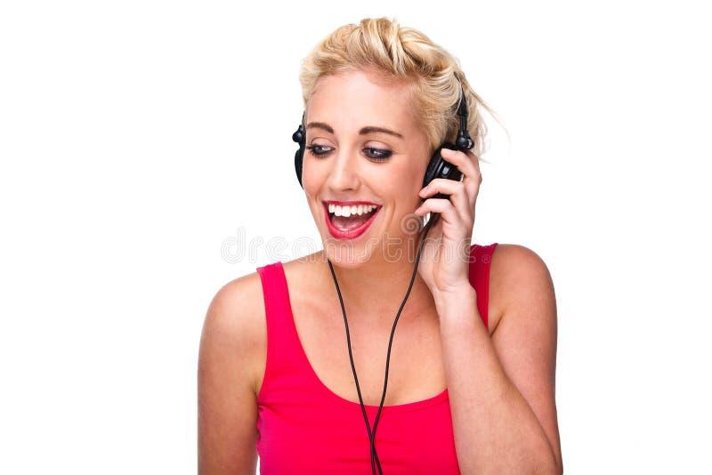 lyssnande musik för hörlurar till kvinnabarn fotografering för bildbyråer