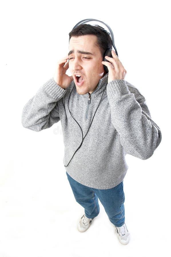 Lyssnande musik för man fotografering för bildbyråer