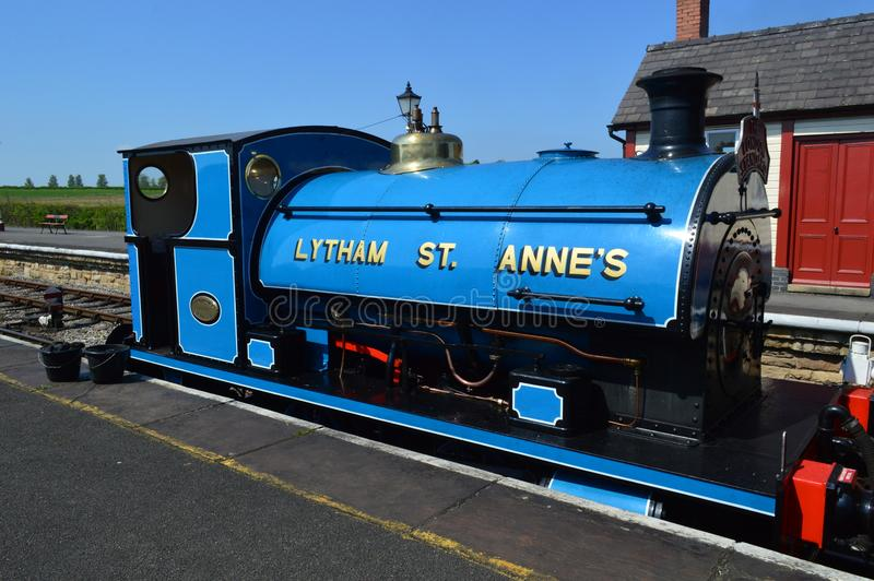 Lytham St Annes Blue Saddle Tank. In front of Little Red and white station at Swanwick Junction Photo taken in springtime april at Midland Railway Centre stock photo