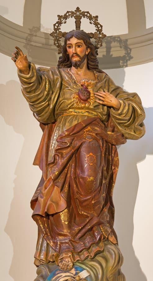 Màlaga - die geschnitzte vielfarbige Statue des gehörten Jesuss in Iglesia-del Santiago Apostol-Kirche stockbilder