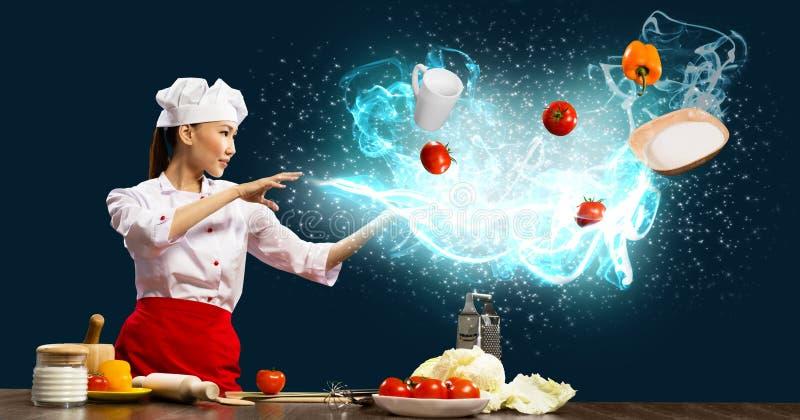 Mágica na cozinha imagem de stock