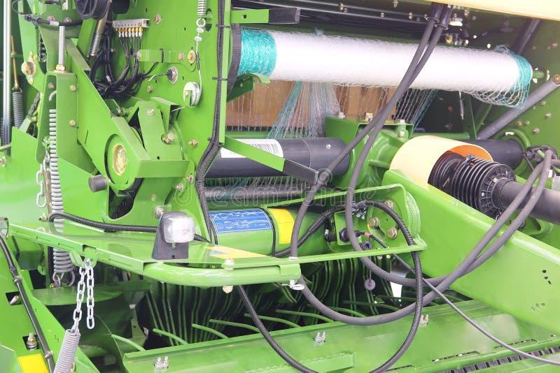 Máquina agrícola para empacotar da colheita imagens de stock royalty free