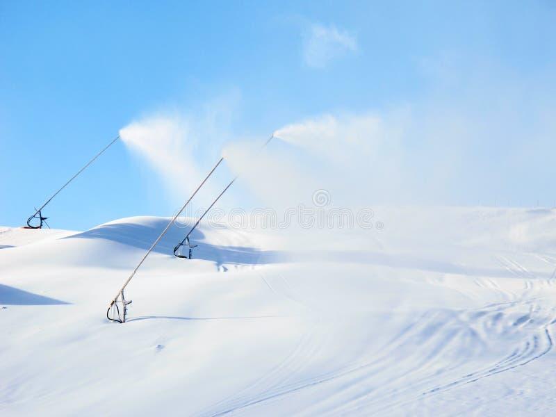 A máquina da neve está nevando foto de stock royalty free