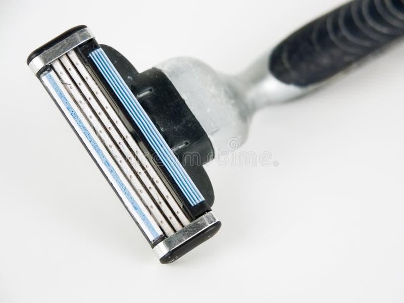 Máquina de afeitar contra el fondo blanco fotos de archivo libres de regalías