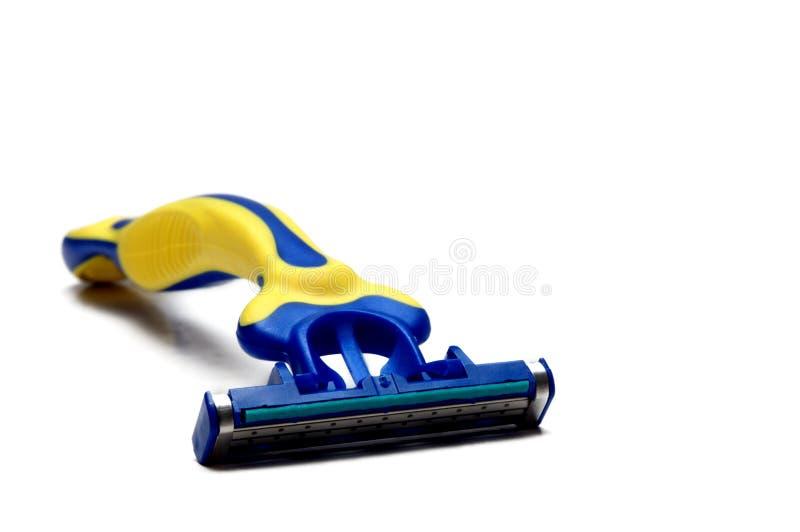 Máquina de afeitar de la mano fotografía de archivo