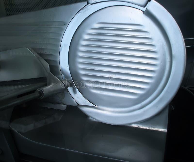 Máquina de cortar de la carne de la tienda de delicatessen imagen de archivo libre de regalías