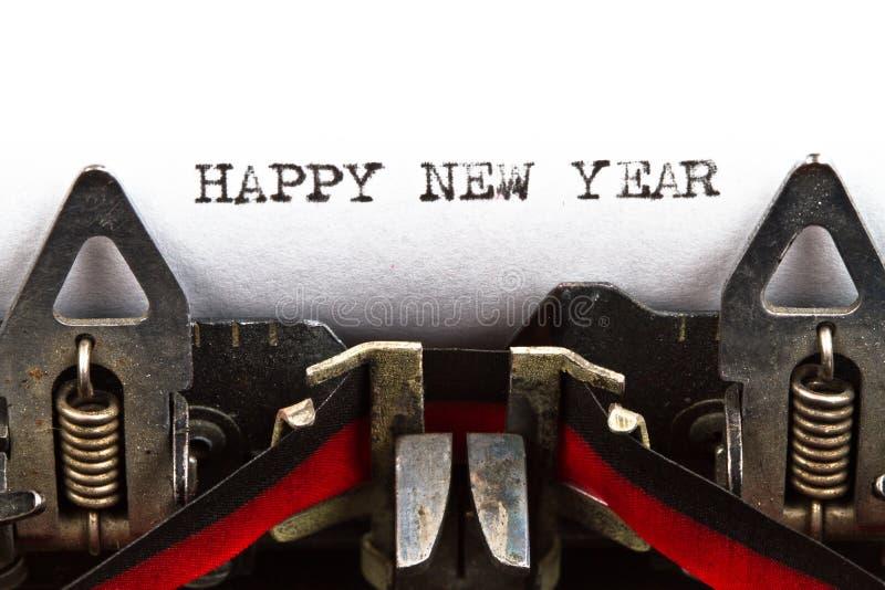 Máquina de escrever com ano novo feliz do texto imagens de stock