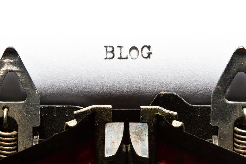 Máquina de escrever com blogue do texto foto de stock