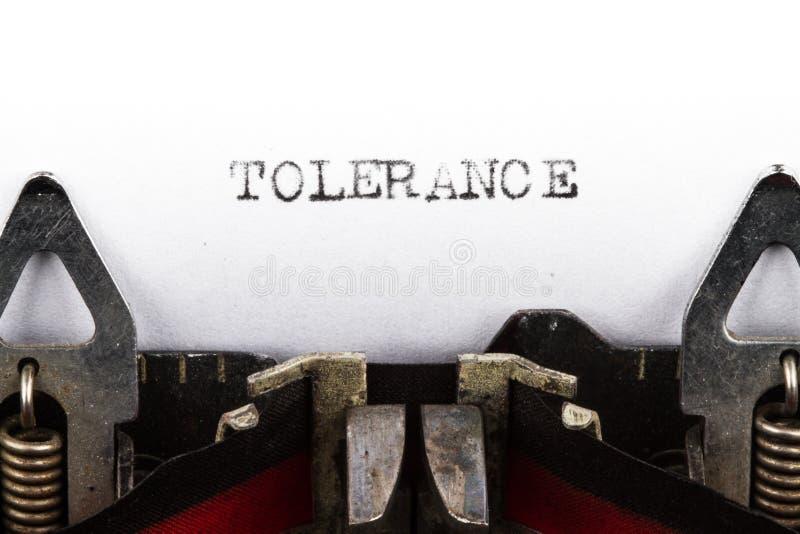 Máquina de escrever com tolerância do texto imagem de stock