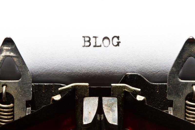 Máquina de escribir con el blog del texto foto de archivo