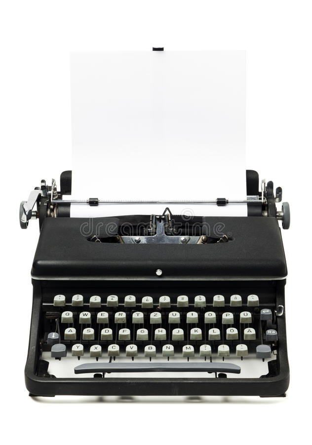 Máquina de escribir vieja arenosa con el papel en blanco fotos de archivo