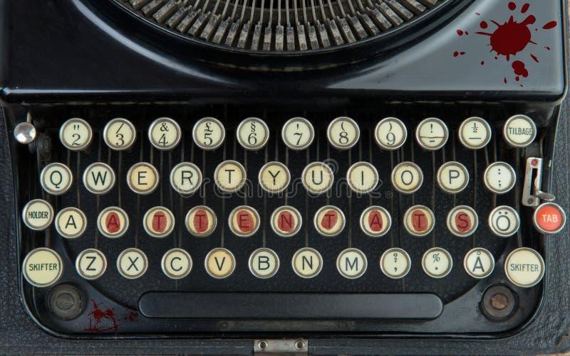 Máquina de escribir vieja con terrorismo foto de archivo