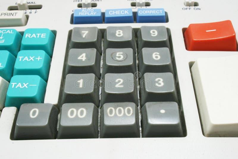 Máquina de la calculadora para la declaración sobre la renta fotografía de archivo libre de regalías