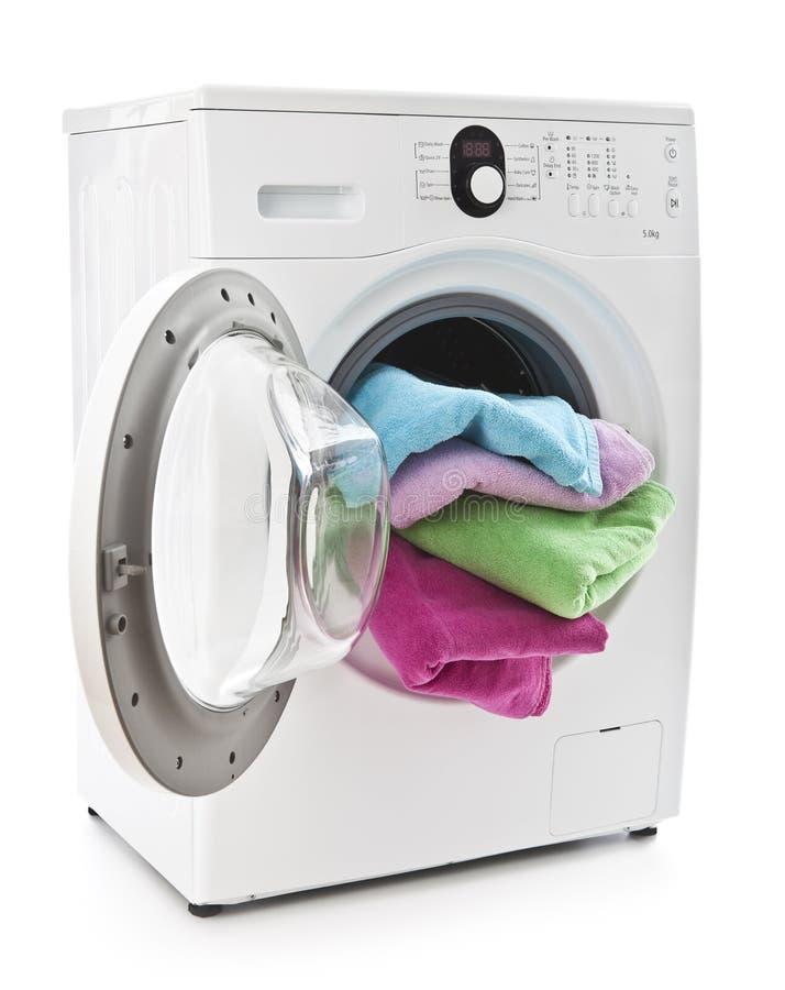 Máquina de lavar com lavanderia foto de stock