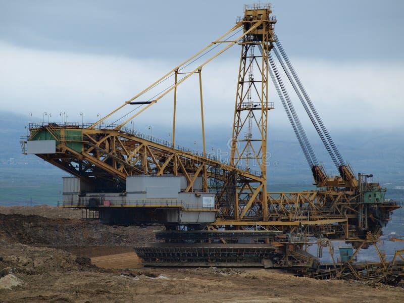 A máquina de mineração, surge a mina de carvão imagem de stock