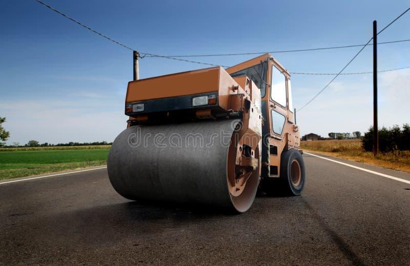 Máquina de pavimentación del asfalto fotos de archivo