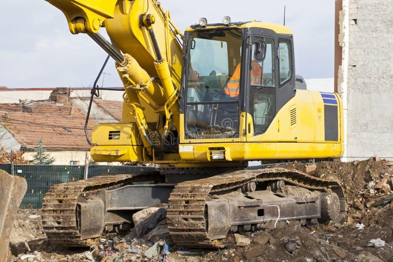 Máquina escavadora amarela hidráulica fotos de stock