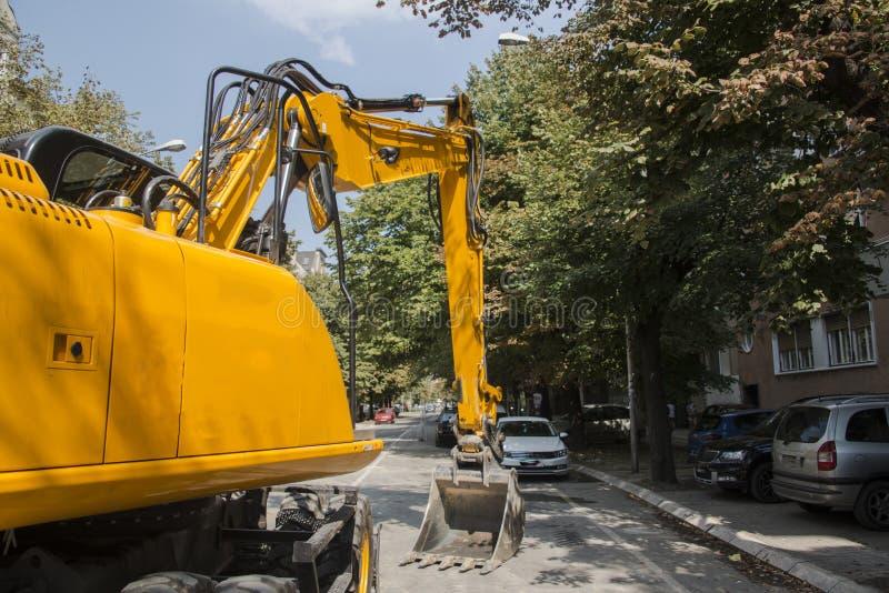 Máquina escavadora, hidráulica, pneus, parafusos fotografia de stock