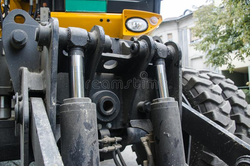 Máquina escavadora, hidráulica, pneus, parafusos imagem de stock royalty free