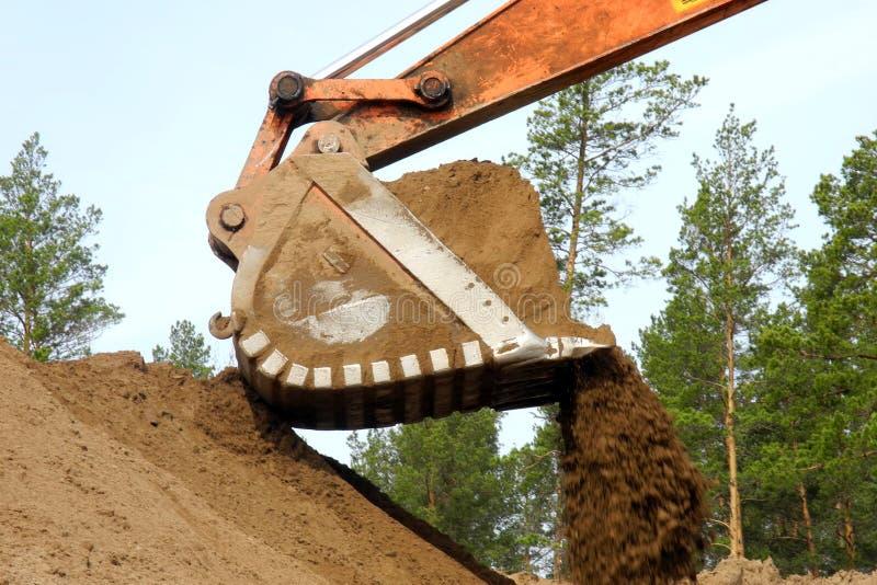 Máquina escavadora no canteiro de obras imagem de stock royalty free