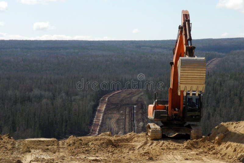 Máquina escavadora no canteiro de obras foto de stock royalty free