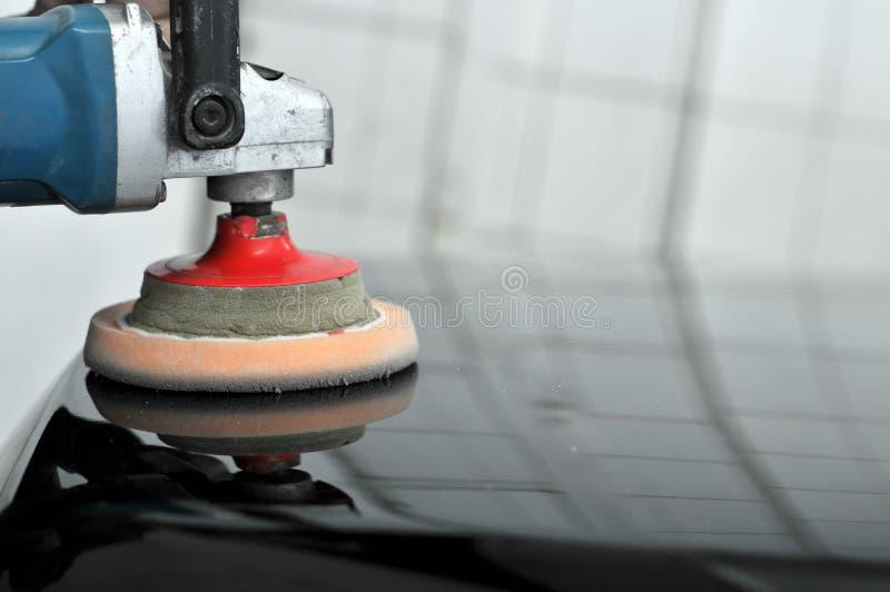 Máquina pulidora del coche. imagenes de archivo