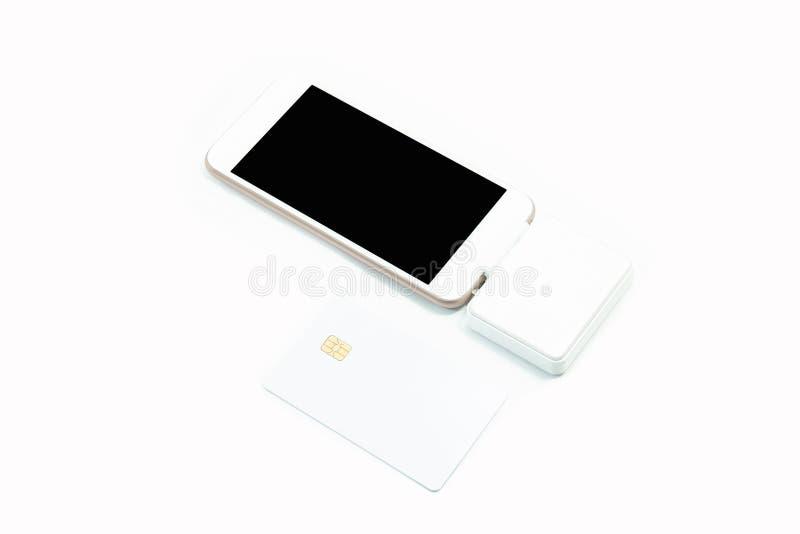 Máquina telefone e de cartões espertos do crédito com o cartão de crédito vazio fotografia de stock