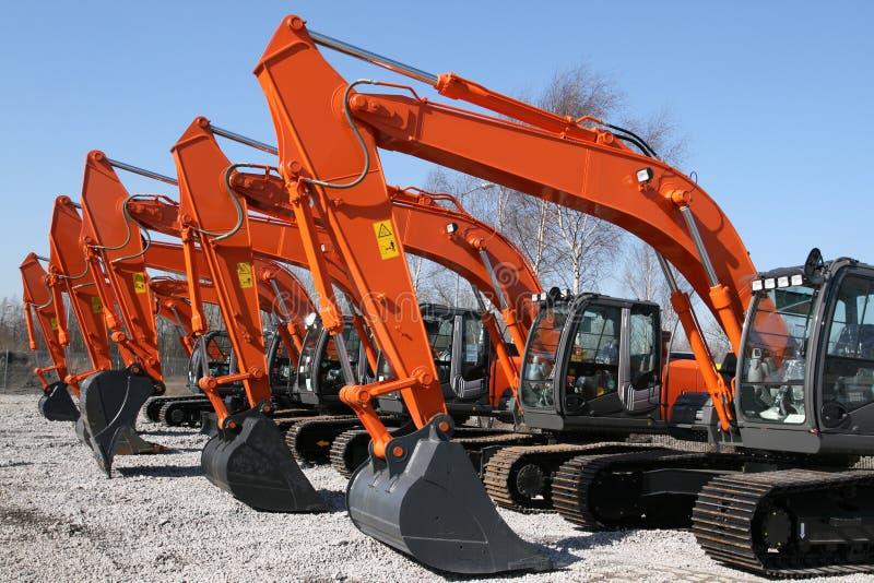 Máquinas escavadoras foto de stock royalty free