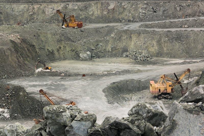 Máquinas escavadoras do grupo imagens de stock