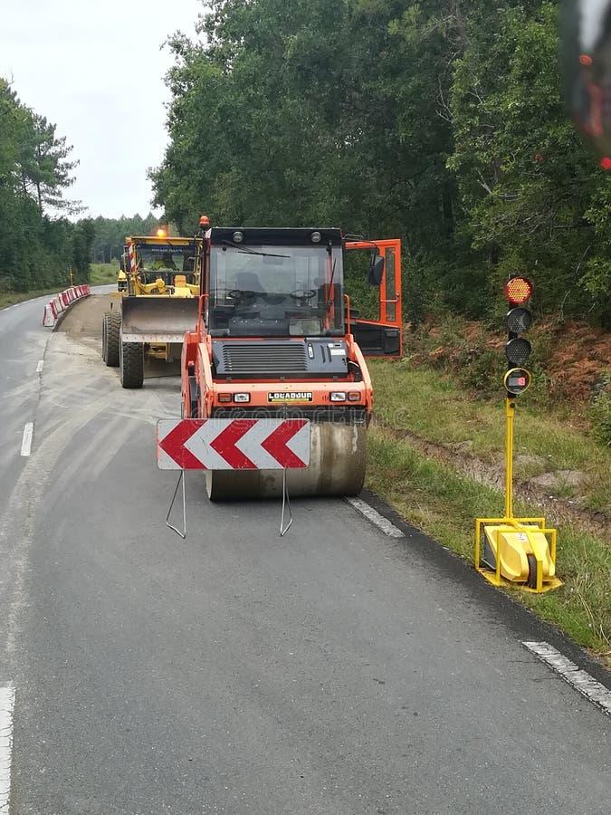 Máquinas que trabalham na estrada fotografia de stock royalty free