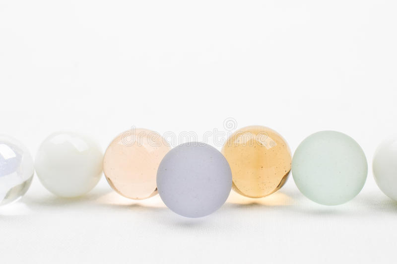 Mármores de vidro nas cores pastel foto de stock