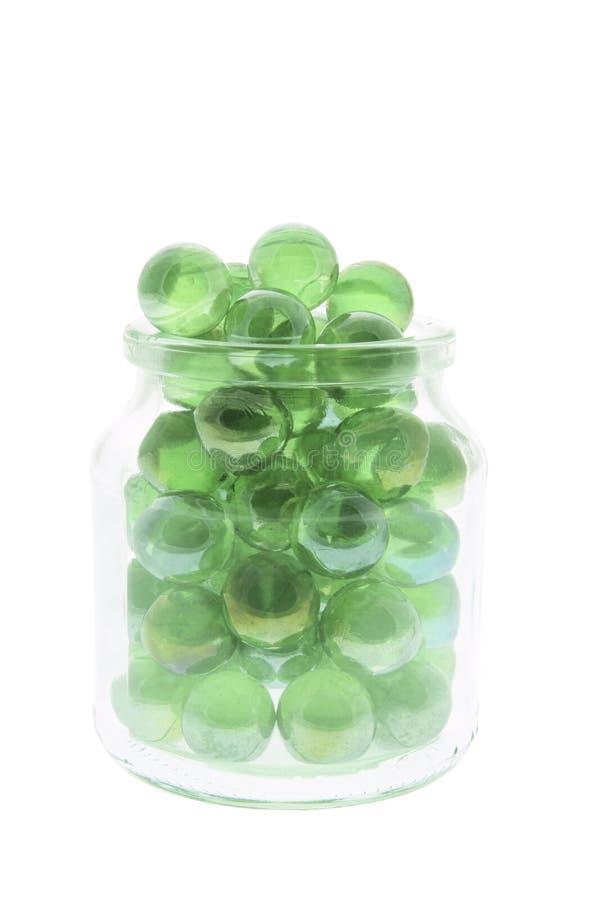 Mármores no frasco de vidro imagem de stock