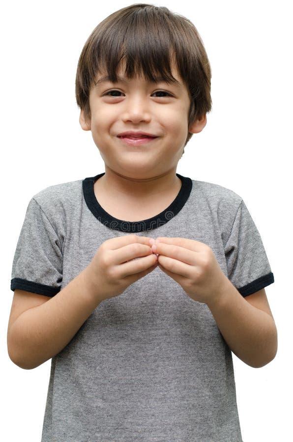Más lenguaje de signos de la mano del niño foto de archivo