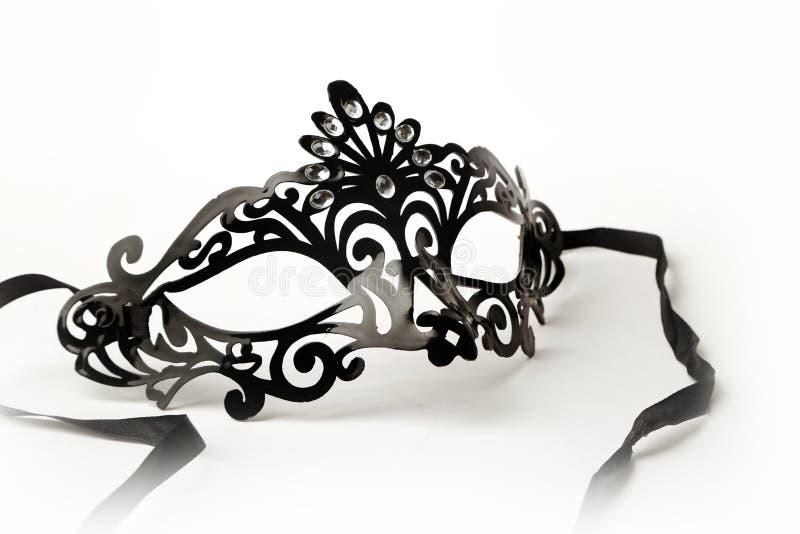 Máscara adornada negra de la mascarada en el fondo blanco imagen de archivo libre de regalías