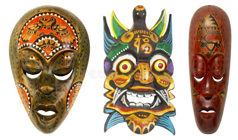Máscara africana do vintage em um fundo branco fotografia de stock