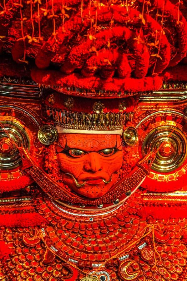 Máscara anaranjada en Kerala fotografía de archivo