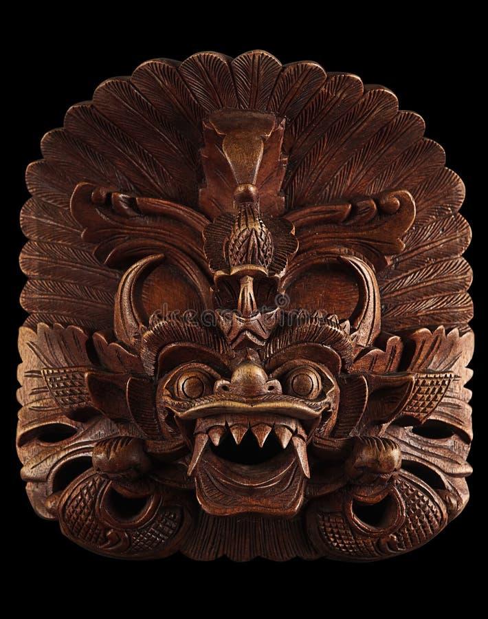 Máscara asiática aislada en negro foto de archivo