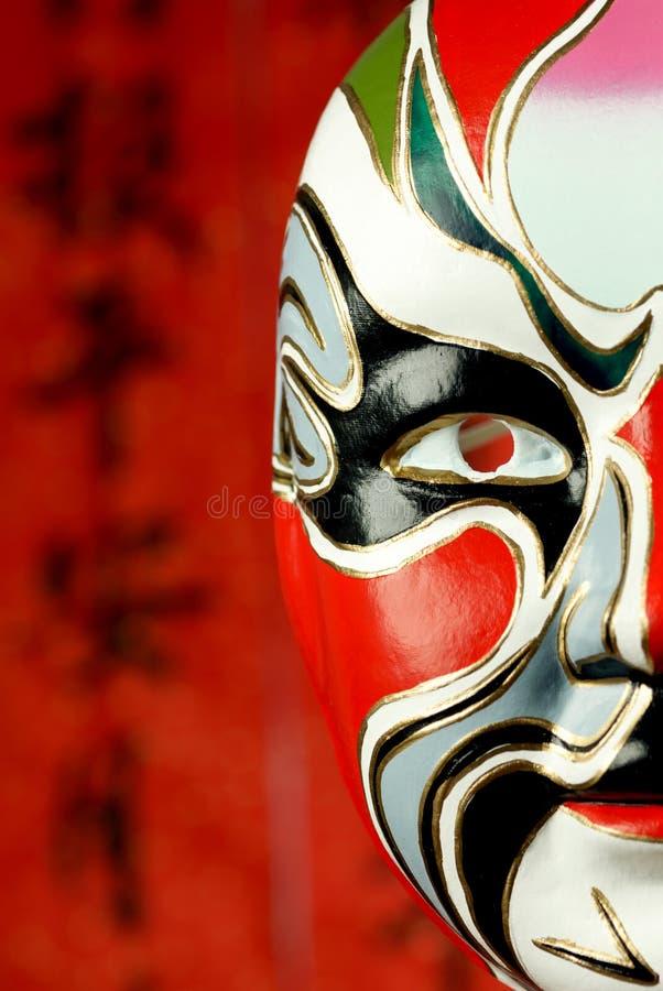Máscara clásica de la ópera de Pekín en fondo festivo fotos de archivo libres de regalías