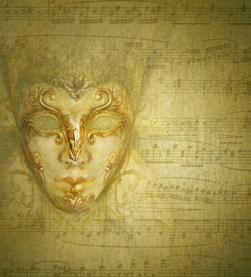 Máscara de oro de la tarjeta fotografía de archivo libre de regalías