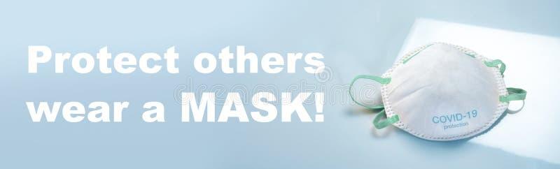 Máscara de protección antivirus ffp2 estándar para prevenir la infección por corona COVID-19 fotos de archivo